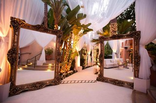 two-large-mirrors-at-wedding-reception-entrance