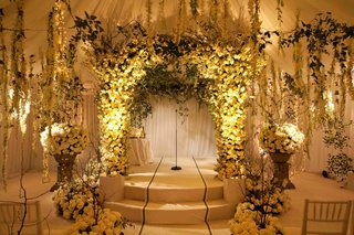 indoor-garden-ceremony-with-white-roses-and-orchids-and-greenery