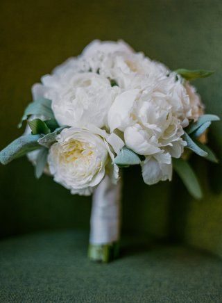 bouquet-of-white-peonies-wrapped-in-white-ribbon