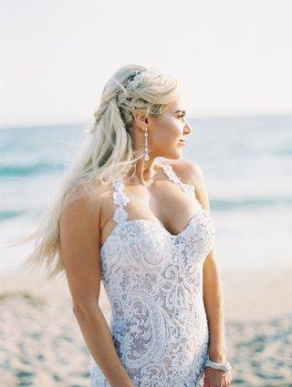 cj-lana-perry-looking-at-sunset-beach-wedding-halter-neck-dress-drop-earrings-headpiece