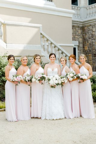 wedding-party-bride-in-romona-keveza-lace-ball-gown-with-bridesmaids-blush-pink-dresses-nosegay-updo