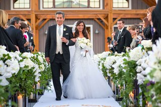 bride-in-carolina-herrera-wedding-dress-walking-down-aisle-with-father-in-three-piece-suit-aspen