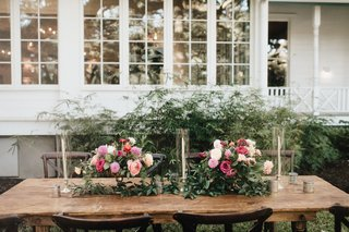 wood-wedding-reception-table-outdoor-greenery-pink-white-flowers-taper-candles