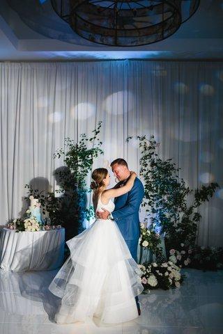 wedding-reception-first-dance-drapery-wall-greenery-climbing-up-flowers-on-dance-floor-sweetheart