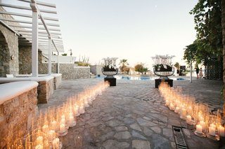 weddinng-reception-entrance-pool-and-pillar-candles-in-glass-hurricanes-white-flowers-black-modern