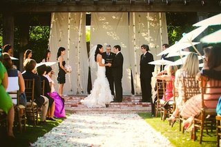 petal-covered-aisle-and-wooden-wedding-canopy