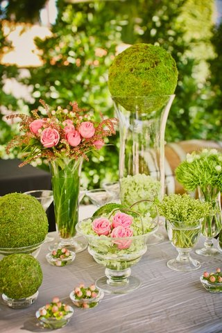 grass-covered-spheres-and-pink-garden-roses