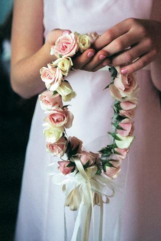 flower-girl-holding-her-floral-crown