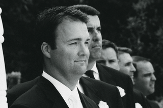 black-and-white-photo-of-men-at-altar