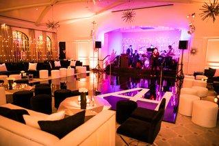 wedding-reception-ballroom-for-dancing-purple-pink-lighting-monogram-dance-floor-black-white-lounge