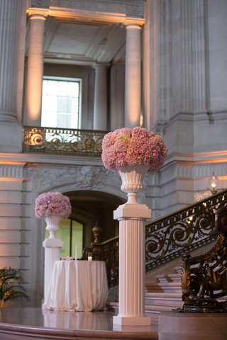 white-risers-with-white-urns-filled-with-pink-hydrangeas-at-bottom-of-city-hall-stairs