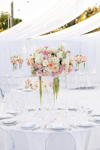 wedding-reception-all-white-space-with-floral-centerpiece-with-shades-of-white-and-pink