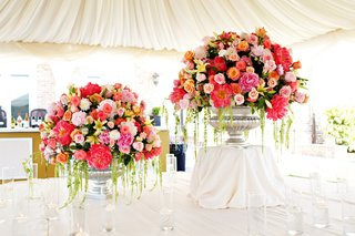 wedding-reception-with-silver-urns-filled-with-pink-white-and-yellow-flowers-and-greenery