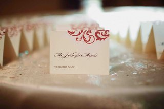 place-card-with-red-scroll-design