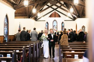 bride-in-gregory-ellenberg-arm-in-arm-with-groom-in-brooks-brothers-tuxedo-recessional