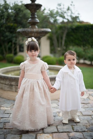 flower-girl-in-short-sleeve-ball-gown-bangs-updo-flowers-ring-bearer-in-boots-and-white-jacket