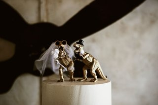 wedding-cake-topper-gold-tyrannosaurus-rex-with-top-hat-and-veil