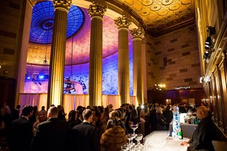 wedding-reception-cocktail-hour-gotham-hall-large-columns-high-ceiling-dome-gold-ceiling