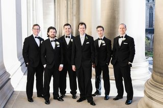 groom-groomsmen-classic-black-tuxedos-roman-catholic-church-ceremony-religious-wedding-smiling