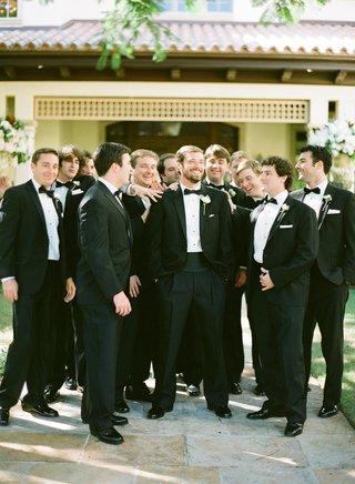 groom-and-groomsmen-in-black-tuxedos