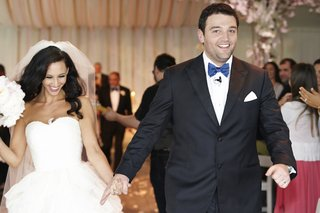 bride-and-groom-walk-up-aisle-holding-hands-in-chicago