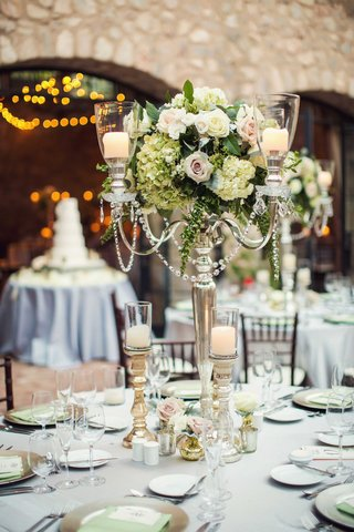 wedding-reception-at-tuscan-inspired-venue-silver-candleabra-hydrangea-roses-gold-candleholders