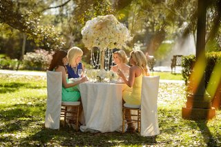 bride-and-mother-of-bride-with-bridesmaids-at-outdoor-table