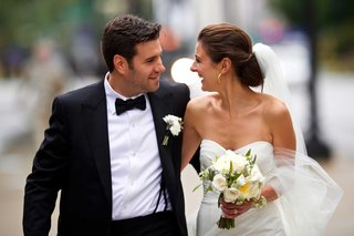 bride-in-strapless-monique-lhuillier-wedding-dress-with-ivory-bouquet-and-groom-in-tuxedo