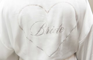 white-silky-robe-with-silver-heart-and-bride-written-on-inside-bride-robe