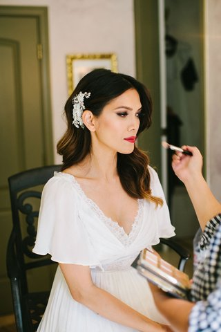 bride-in-v-neck-wedding-dress-with-flutter-sleeves-glamorous-curls-headpiece-red-lipstick-makeup