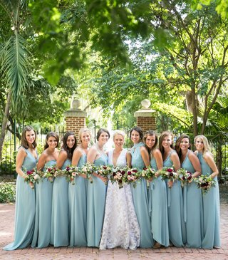 bride-in-white-dress-and-bridesmaids-in-blue-with-fall-theme-bouquets-key-west-wedding