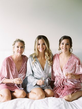 bride-in-grey-velvet-robe-with-sister-and-mom-in-dusty-rose-velvet-robes-velvet-getting-ready-robes