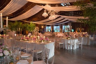 rustic-venue-with-wooden-ceilings-drapery-and-twinkle-lights