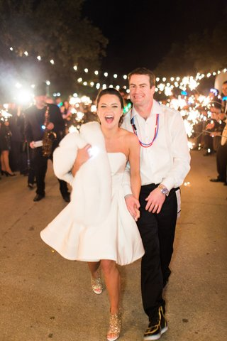 bride-and-groom-after-wedding-short-strapless-dress-fur-wrap-blinky-lights-and-shoes-sparklers