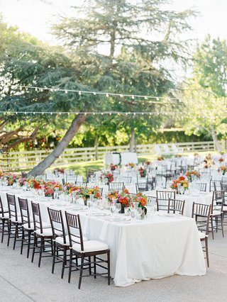 long-family-wedding-table-with-low-flower-arrangements-and-white-linens
