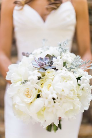 bride-holding-white-bouquet-peony-rose-stephanotis-blossom-greenery-succulent-purple-green