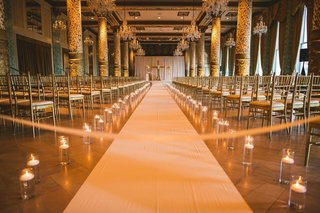 wedding-ceremony-at-the-drake-hotel-chicago-white-aisle-runner-hurricane-vase-candles-candlelight