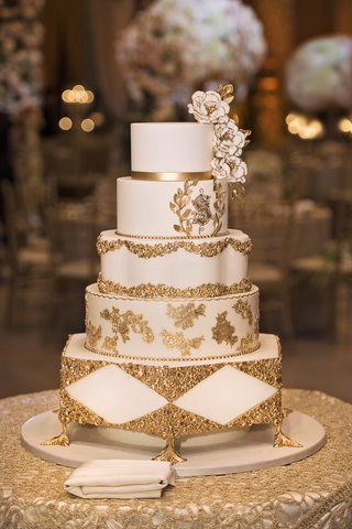 small-four-tiered-wedding-cake-with-gold-details-and-sugar-flowers