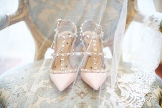 wedding-day-heels-pink-pointed-toe-pumps-studs-gold-heels-on-chair-with-veil-over