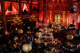 wedding-reception-at-angel-orensanz-foundation-for-the-arts-with-red-lighting-and-beaded-chandeliers