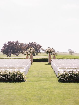 outdoor-wedding-ceremony-the-lodge-at-torrey-pines-greenery-white-rose-flowers-chairs-golf-course