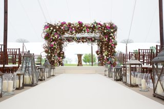 chuppah-with-pink-flowers-branches-greenery-lanterns-tented-venue-jewish-ceremony