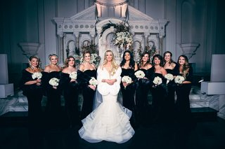 bride-in-mermaid-wedding-dress-with-fur-wrap-bridesmaids-in-black-velvet-dresses-with-fur-wraps