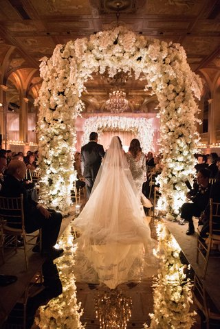the-plaza-wedding-ceremony-flower-arch-mirror-aisle-jewish-wedding-ceremony