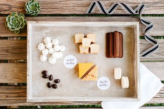 cheddar-cheese-and-desserts-in-box-for-wedding-guests