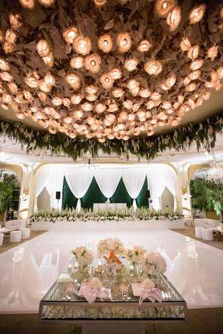 wedding-reception-white-dance-floor-with-sweetheart-table-crystal-and-flower-decor-live-band-stage