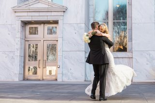 josh-hugs-and-lifts-bride-after-their-first-look-photography-session