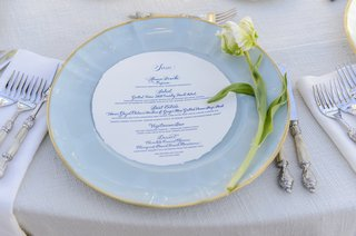 gold-rim-light-blue-plate-with-single-tulip-flower-at-wedding