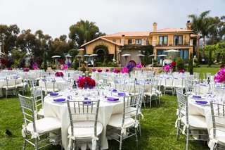 white-tables-with-purple-napkins-and-pink-centerpieces