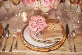 wedding-reception-shoot-with-gold-plate-and-pink-flowers